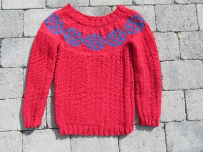 Knitted sweater with footballs